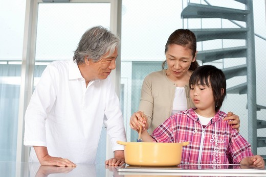 Grandparents and grandson cooking in kitchen : Stock Photo
