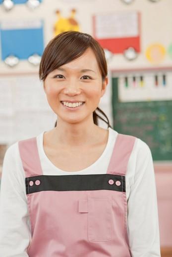 Stock Photo: 1436R-347023 Kindergarten Teacher Smiling