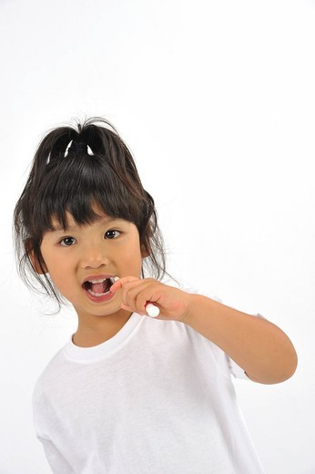 Stock Photo: 1436R-348505 Girl brushing teeth