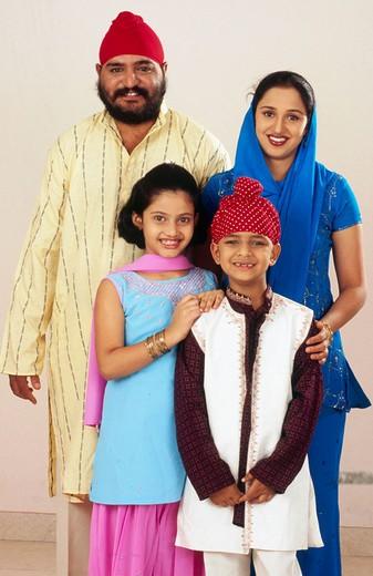 Stock Photo: 1436R-352771 Indian Sikh Punjabi family of four from India.