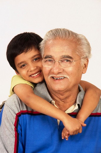 Grandson with arms around Grandfather : Stock Photo
