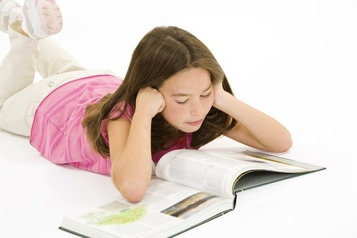 Child working on homework on white background : Stock Photo