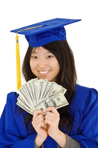 Stock Photo: 1436R-362212 An Asian teenage in blue graduation gown and smiling while hold US money to illustrate to high cost of education  She is on a white background