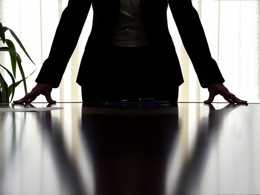 Woman manager in a business stance during a meeting : Stock Photo
