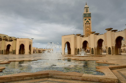 Minaret and fountains at the Hassan II Mosque in Casablanca Morocco on a stormy day : Stock Photo
