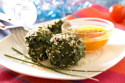 Stock Photo: 1436R-425716 Meat balls wrapped in spinach leaves sesame seeds and vinegrette sauce bowl