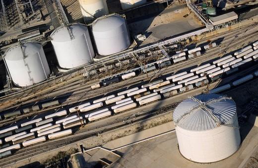 Stock Photo: 1436R-426058 Oil tank and trains on railroad tracks, Lavera, France