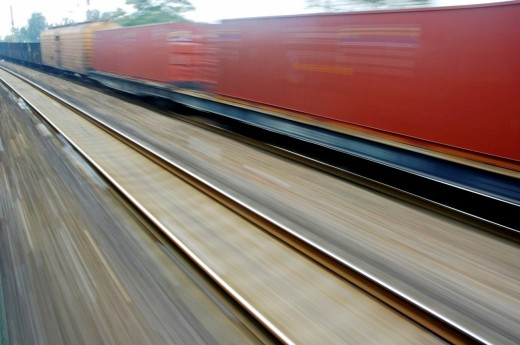 Stock Photo: 1436R-426072 Blurry carriages of a freight train travelling at high speed, China