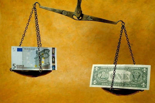 Scale weighing a five euro banknote and a one dollar banknote : Stock Photo