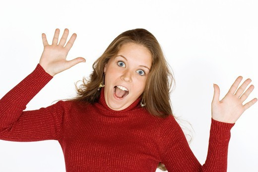 Woman looking surprised : Stock Photo