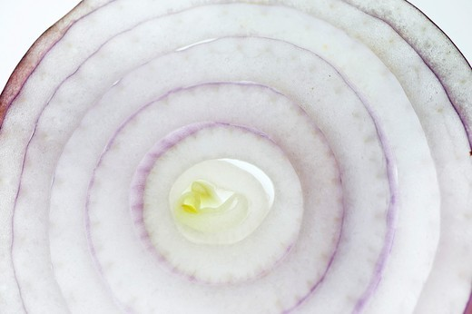 Stock Photo: 1436R-428093 Cut Purple red onion on white Background