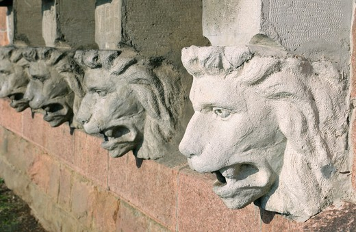 Stone lions´ heads in a row : Stock Photo