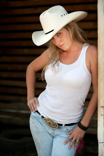 Stock Photo: 1436R-429883 Sexy cowgirl posing on a ranch