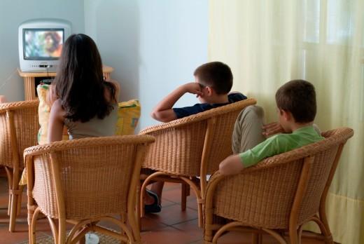 Stock Photo: 1436R-430052 Three children watching television