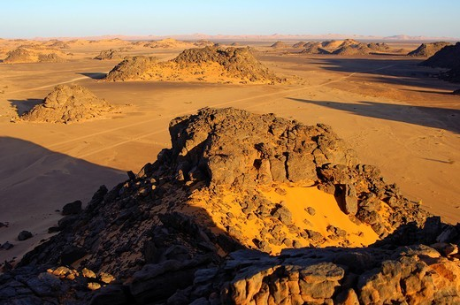 Desertscape with eroded rock hills in the Acacus Mountains, Sahara desert, Libya : Stock Photo