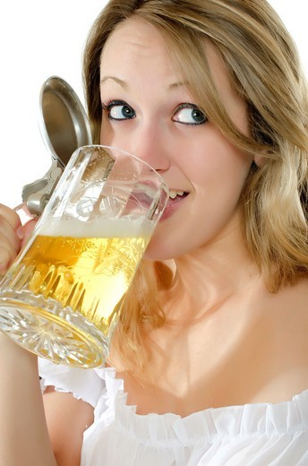 Stock Photo: 1436R-430636 Woman in dirndl dress with beer mug