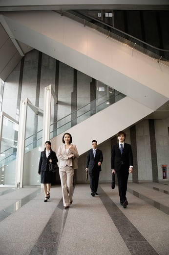 Stock Photo: 1436R-431512 Businessmen and businesswomen standing at lobby of building