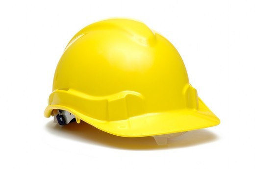 Yellow protective hard hat or helmet on white background : Stock Photo