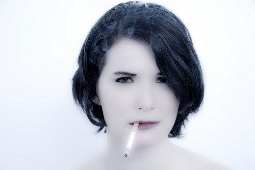 Young woman with a cigarette : Stock Photo