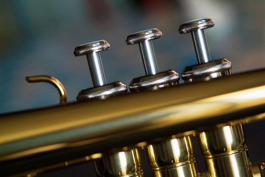 Three musical keys on a shiny trumpet : Stock Photo