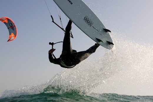 Kitesurfing in the Mediterranean sea Photographed from within the water : Stock Photo