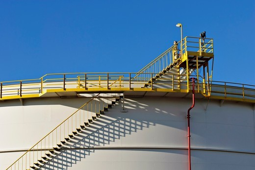 Detail of industrial storage tank with metal stairway : Stock Photo