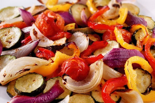 Mixed roast vegetables, onions, peppers and courgette : Stock Photo
