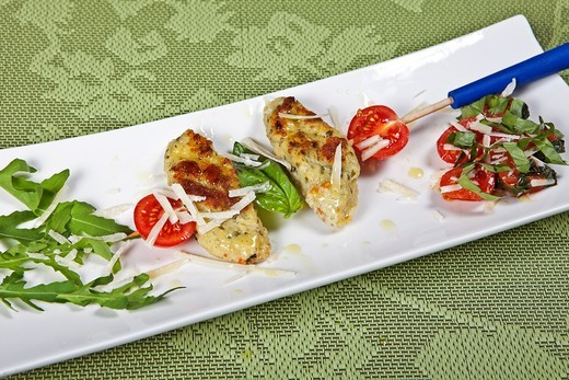 Stock Photo: 1436R-435543 Quark dumplings when Spiess arugula with tomatoes
