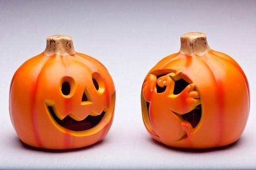 Plastic Halloween Jack o´ Lantern decoration imitating curved pumpkin : Stock Photo