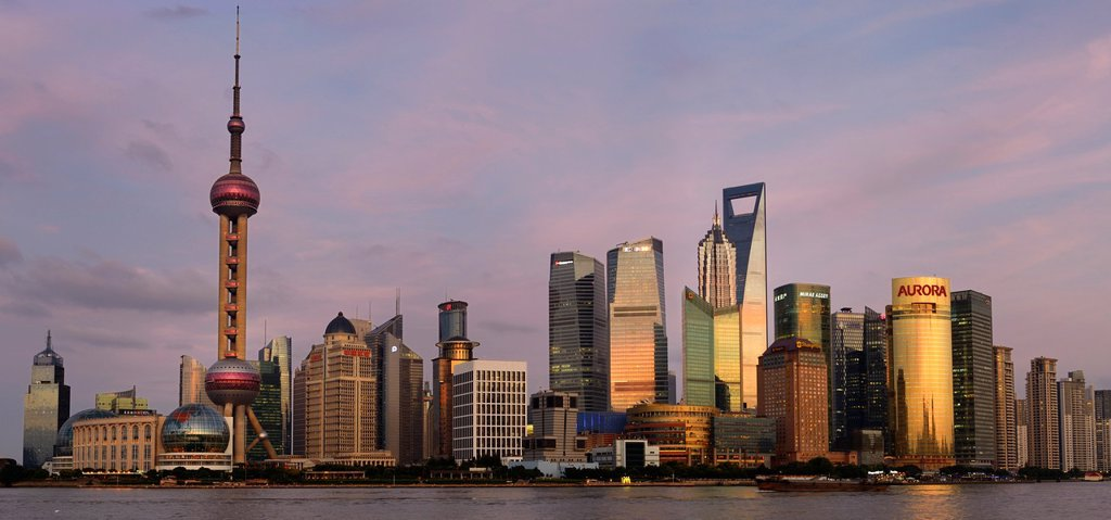 Stock Photo: 1436R-439679 Red sky and dusk light on high rise financial towers and hotels in the Pudong east side of Shanghai China