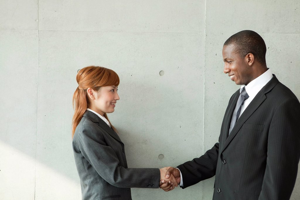 Stock Photo: 1436R-440311 Businessman and businesswoman shaking hands
