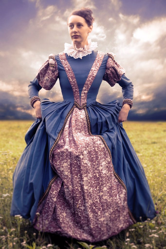 Stock Photo: 1436R-442228 a woman in a renaissance dress in a meadow