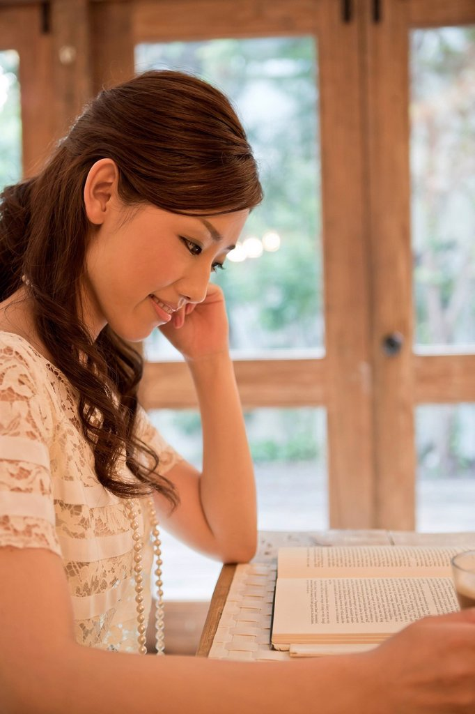 Stock Photo: 1436R-442596 Young Woman Reading Book