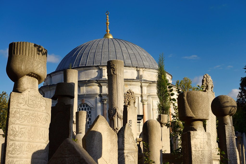 Stock Photo: 1436R-444439 Sun on grave stones and Mausoleum in the Ottoman cemetery at Eyup Sultan Mosque Istanbul