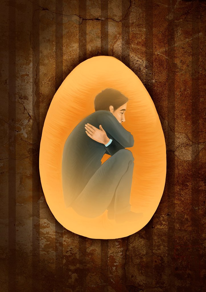 Side view of a man crouching inside egg depicting the concept of prisoner of mind : Stock Photo