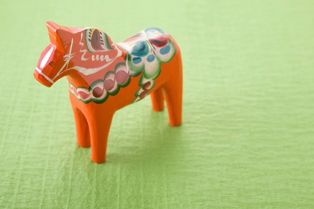 Stock Photo: 1436R-450183 Dala Horse on Green Paper