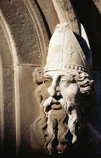 Stone head, said to be of St. Patrick, at the Church of the Most Holy Trinity. Dublin Castle. Ireland : Stock Photo