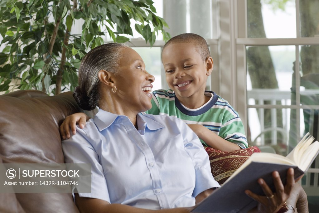 Stock Photo: 1439R-1104746 A grandmother and grandson reading a book