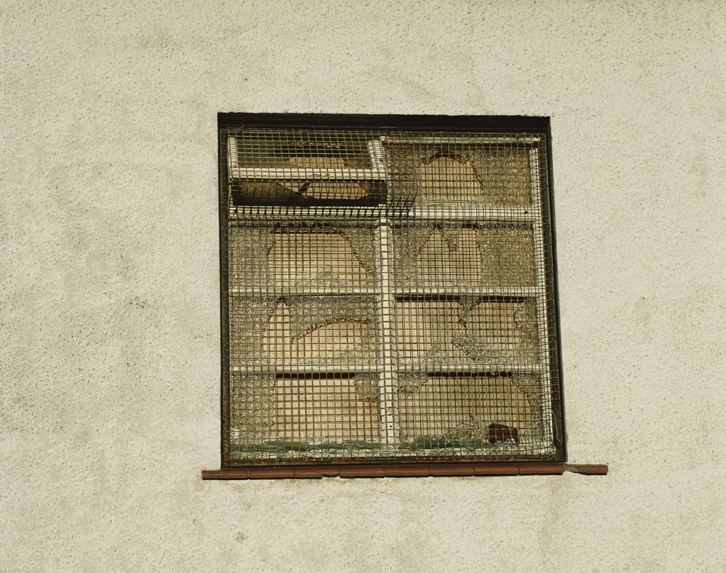 A boarded up window : Stock Photo