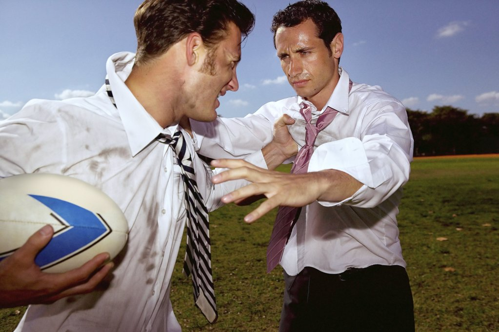 Stock Photo: 1439R-02339 Businessmen playing rugby