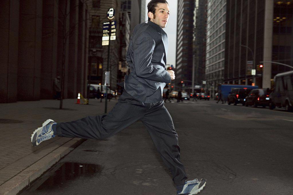 Stock Photo: 1439R-02341 Businessman running through city