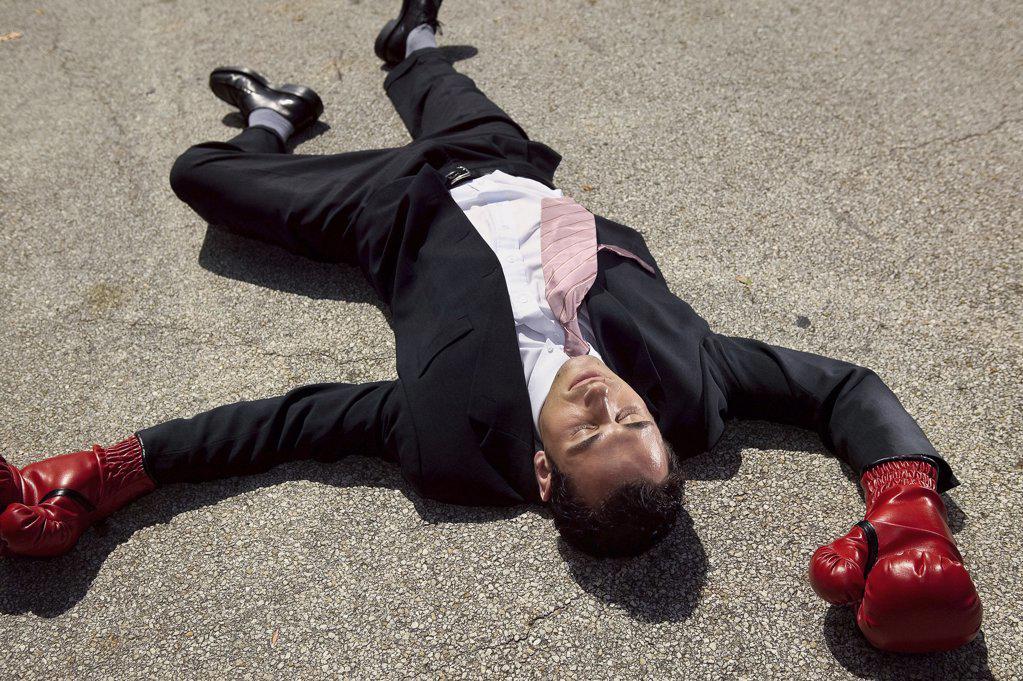 Businessman unconscious on floor : Stock Photo