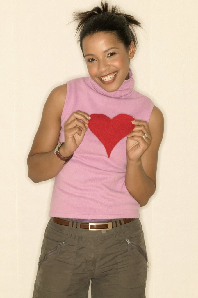 Young woman holding a heart shape : Stock Photo