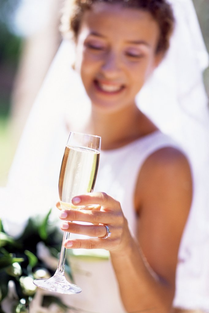 Bride having champagne : Stock Photo