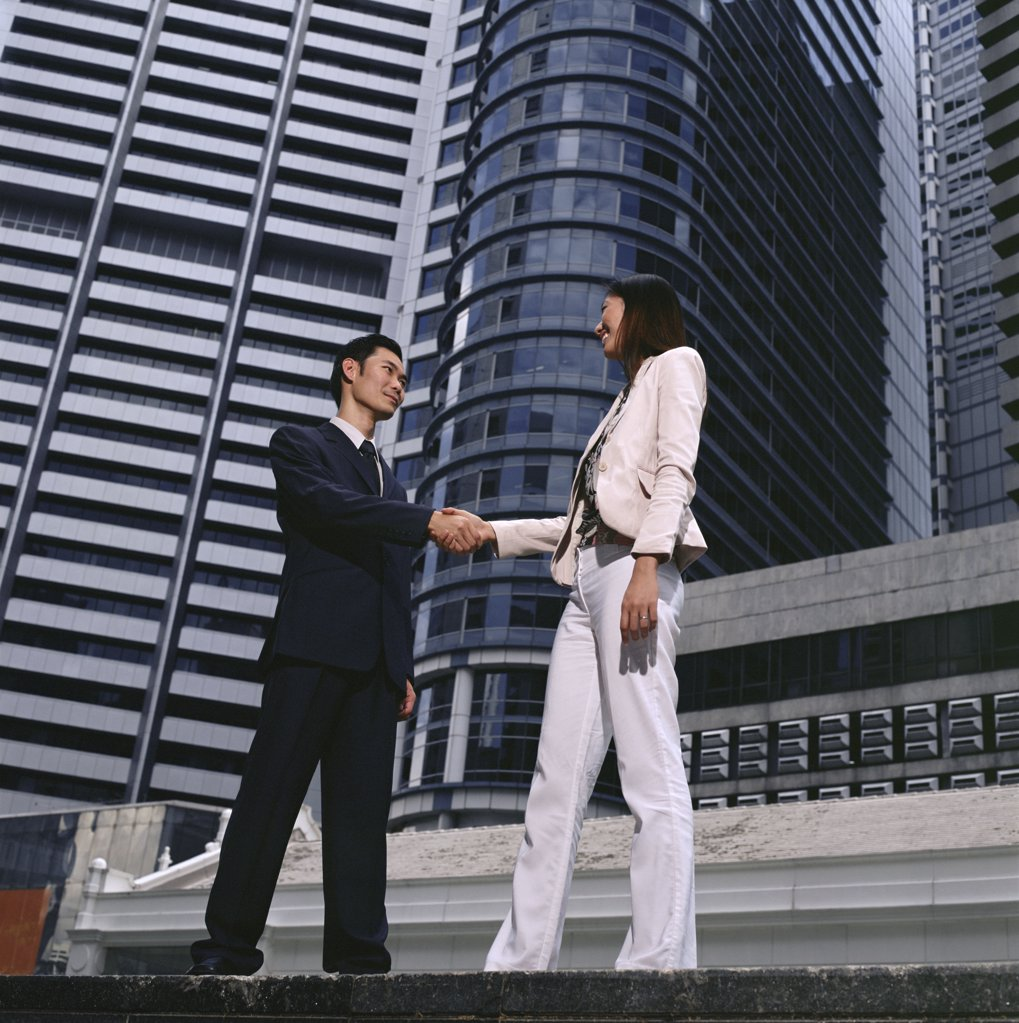 Stock Photo: 1439R-04154 Businesspeople shaking hands