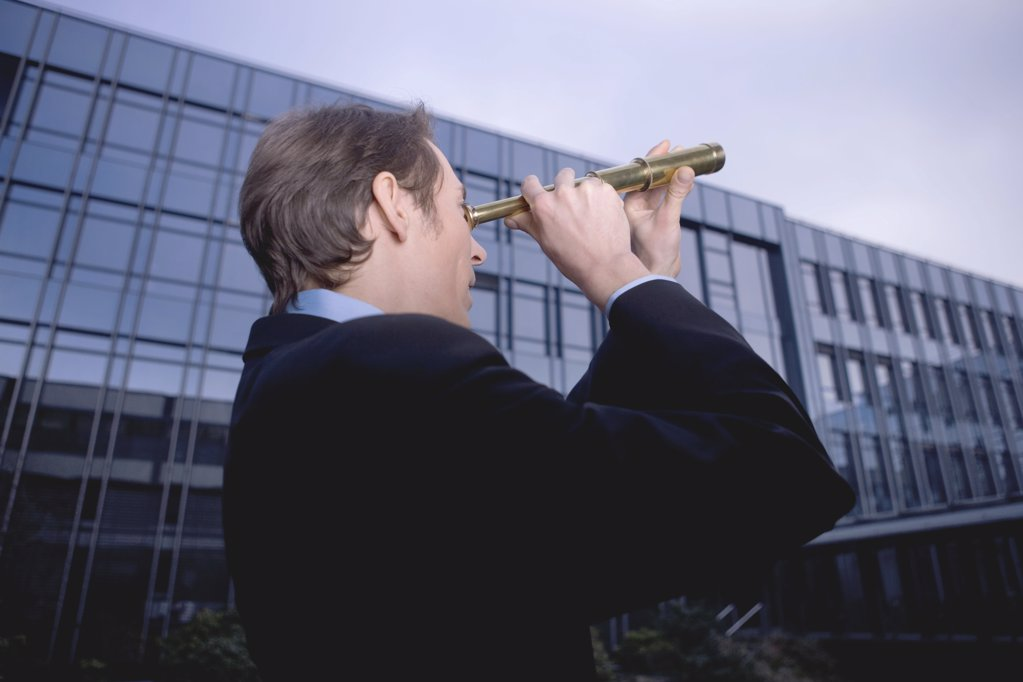 Stock Photo: 1439R-04196 Businessman with telescope