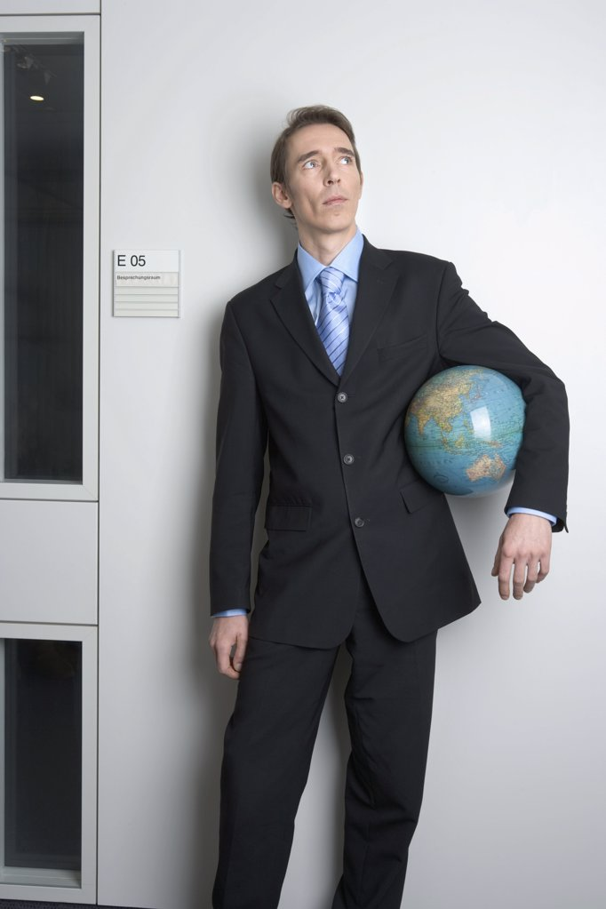 Stock Photo: 1439R-04211 Businessman holding globe