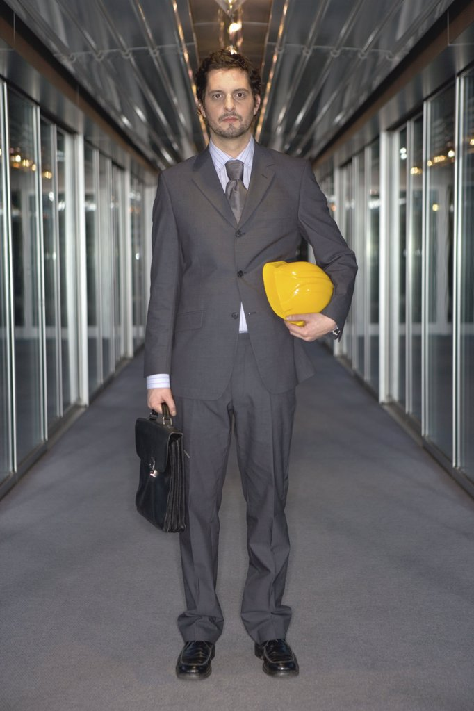 Businessman with hard hat : Stock Photo