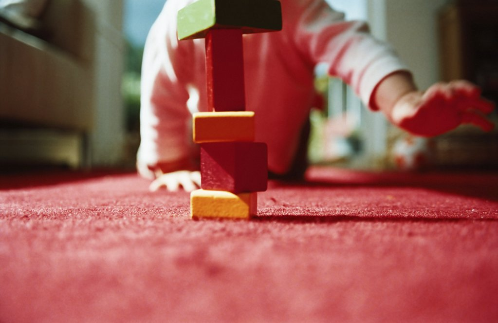 Crawling baby and building blocks : Stock Photo