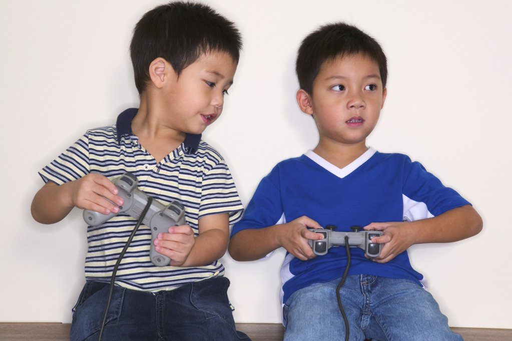 Stock Photo: 1439R-05225 Boys playing video game